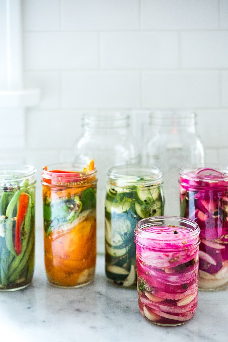 50 MUST-TRY FARMERS MARKET RECIPES! Extend the life of summer produce with this easy recipe for Quick Pickled Veggies! A simple step by step guide to refrigerator pickles! #pickles #refrigeratorpickles #pickledveggies | Feasting At Home