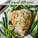 Oven Baked Salmon with Asparagus and Yogurt Dill Sauce - an EASY healthy, sheet-pan dinner that comes together in under 30 minutes. #salmon #roastedsalmon #bakedsalmon #aspargus #dinner #sheetpandinner #easyrecipes #healthy #keto #lowcarb
