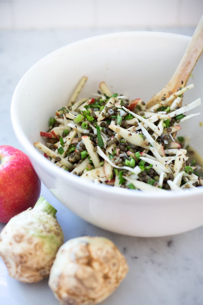 Celery root, apple and lentil salad with a cumin seed dressing. This healthy vegan salad can be made ahead for midweek lunches or fall potlucks and gatherings. #lentilsalad #vegansalad #fallsalad #celeryroot #celeriac #applesalad
