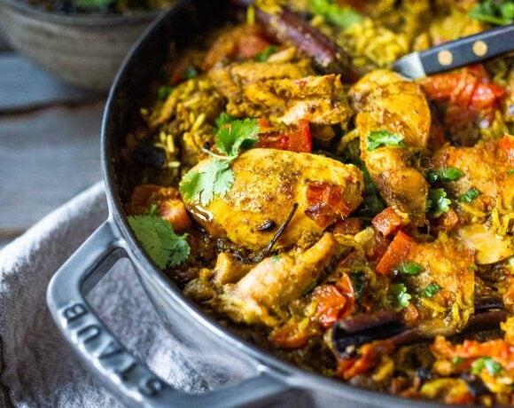 An authentic & insanely delicious recipe for Chicken Biryani with Cilantro Yogurt Sauce. | www.feastingathome.com #chickenbiryani #indianrice #indianchicken