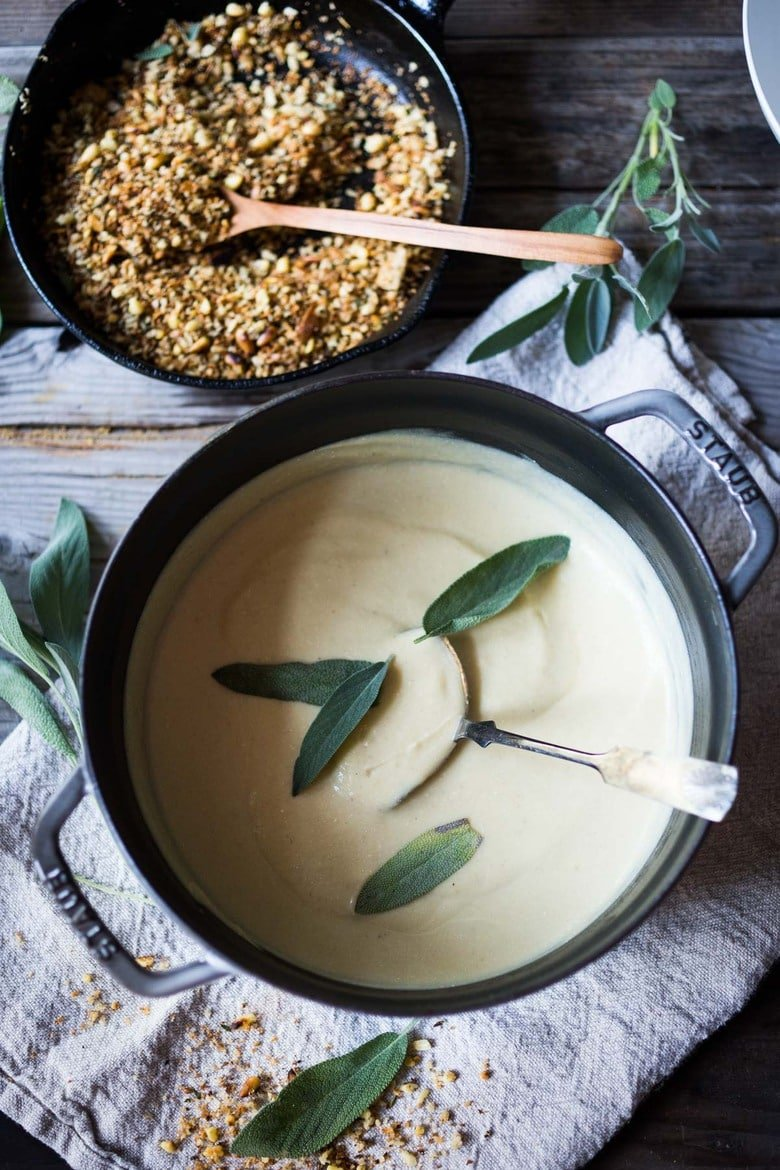 "Creamy Cauliflower Soup with garlic and sage, topped with an optional pine nut""crumble"" - healthy, quick and easy, perfect for weeknights when time is short. 