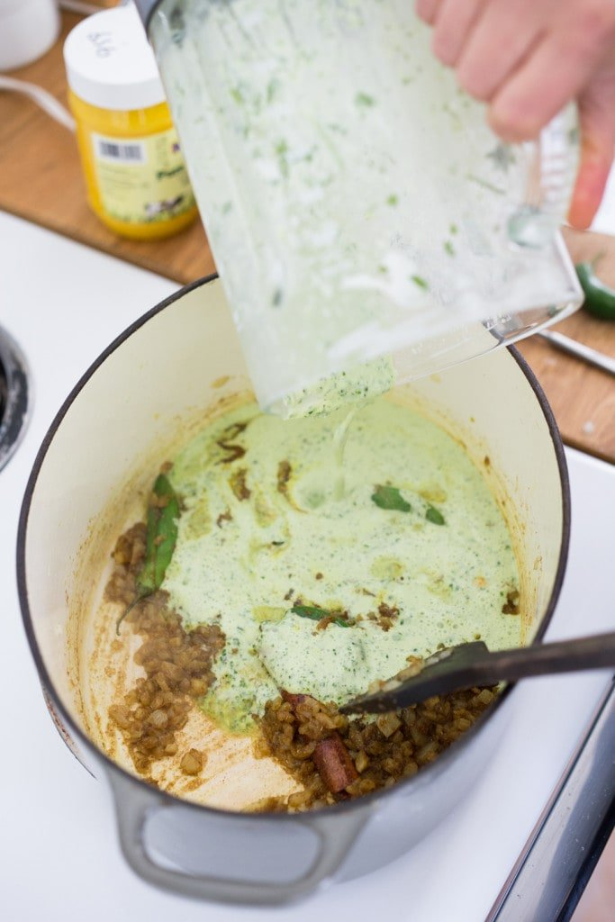 An authentic & insanely delicious recipe for Chicken Biryani with Cilantro Yogurt Sauce. Vegetarian option included as well as detailed step by step instructions. | www.feastingathome.com