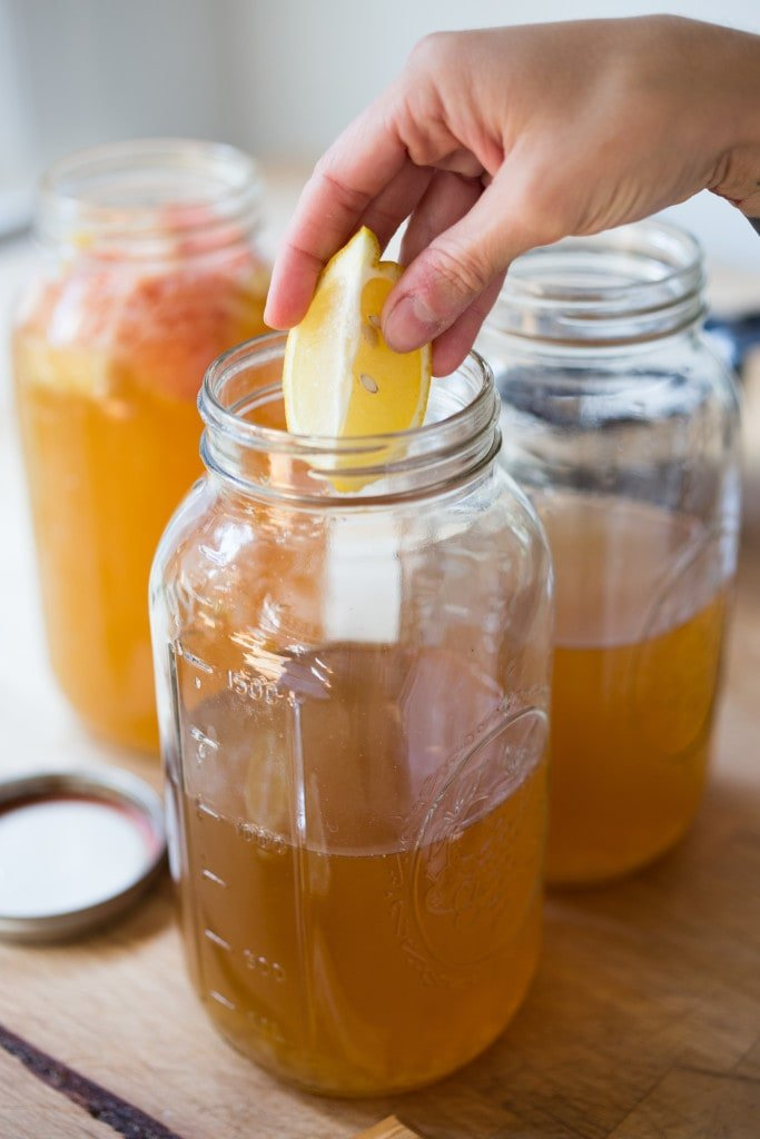 How to make Water Kefir- A simple step-by-step guide to making delicious Water Kefir, a fruit-infused, slightly fermented sparkling fruit water full of healthy probiotics, like yogurt but without the dairy! | www.feastingathome.com