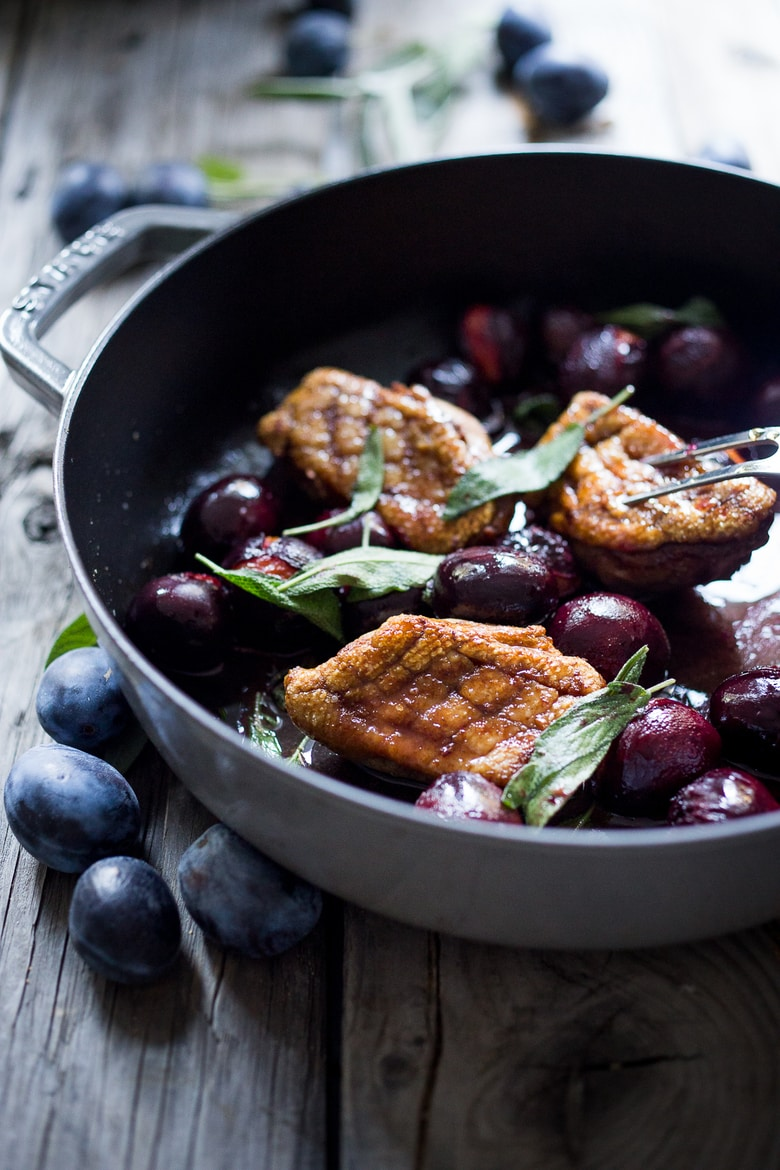Crispy-skinned Duck with Roasted Plums, Cider Glaze and crispy sage- a simple elegant meal highlighting fall plums that can be made in 40 minutes!