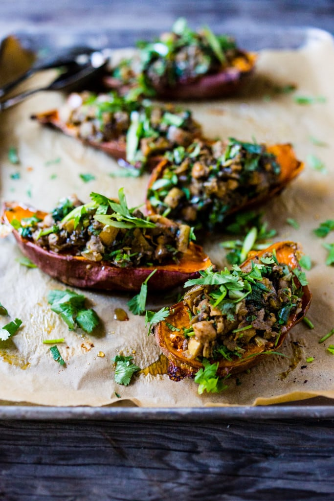 Healthy Moroccan Stuffed Sweet Potatoes w/ Ras El Hanout, chickpeas, apples, onion, garlic & cilantro is vegan, or drizzle with delicious smoked yogurt. | www.feastingathome.com @feastingathome