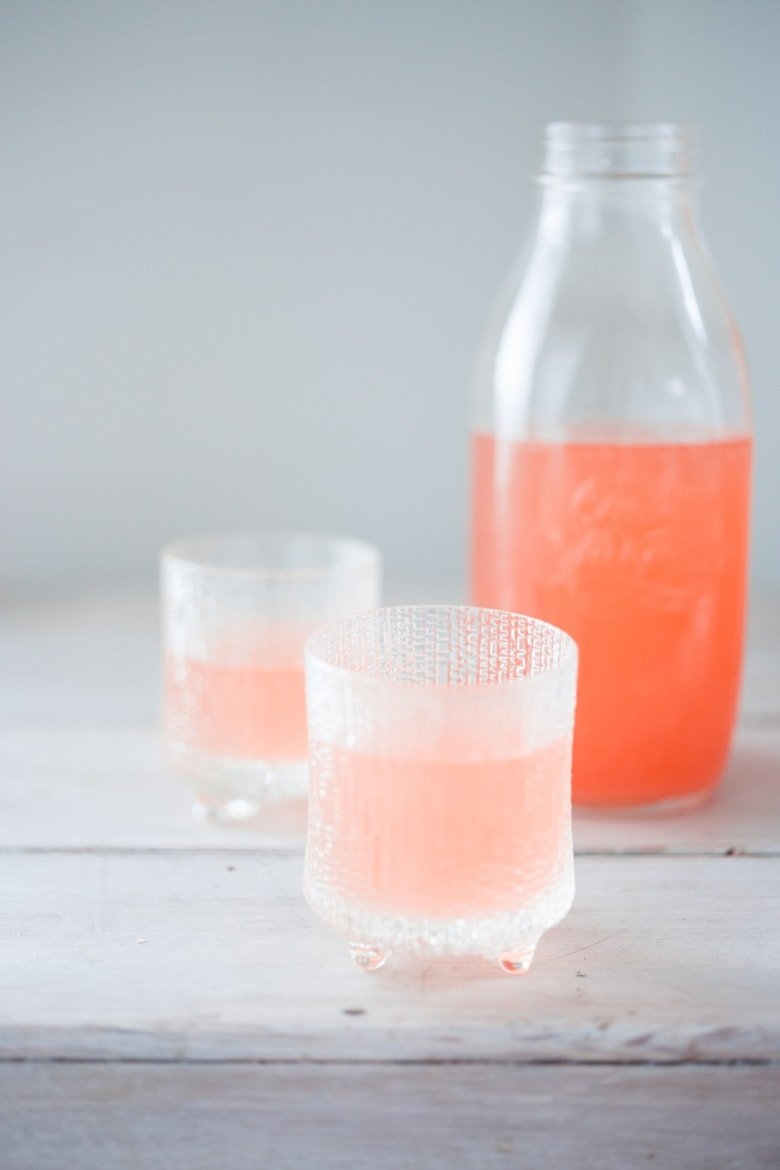 Strawberry Peach Water Kefir, full of healthy probiotics, good for the gut, like Kombucha but BETTER and EASIER! A simple step by step guide | www.feastingathome.com