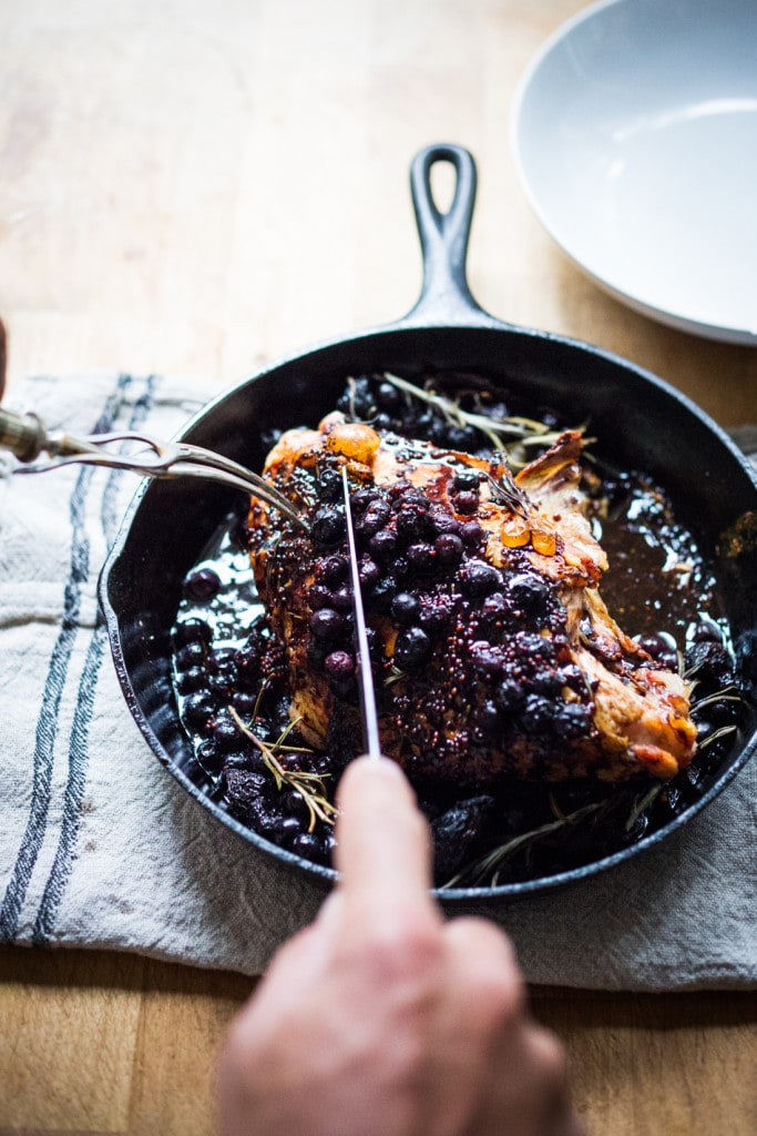 A delicious recipe for Roasted Turkey Breast with Blueberry Balsamic Glaze with whole grain mustard, dried figs, roasted blueberries and fresh rosemary sprigs. | www.feastingathome.com