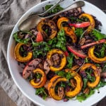 This delicious Thanksgiving Fall Salad with Roasted Pumpkin, Kale, Apples and Wild Rice, is topped with Maple glazed Pecans, Dried Cranberries, and a scrumptious, healthy, Allspice Vinaigrette. Vegan! #thanksgivingsalad #fallsalad #vegansalad #holidaysalad #pumpkin #wildricesalad #kalesalad #applesalad #thanksgiving #salad