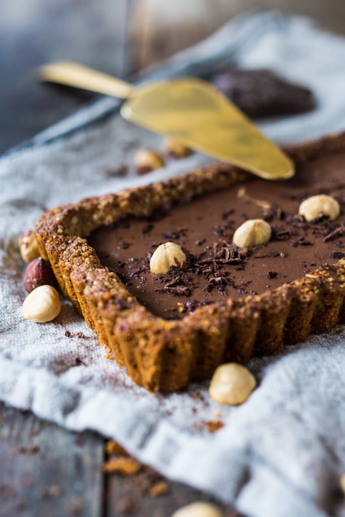 Chocolate Tart with Hazelnut Crust- a vegan and gluten-free tart that is deceptively decadent, silky smooth and luscious! | #vegantart #vegandessert #glutenfreedessert #hazelnuts #chololatetart www.feastingathome.com