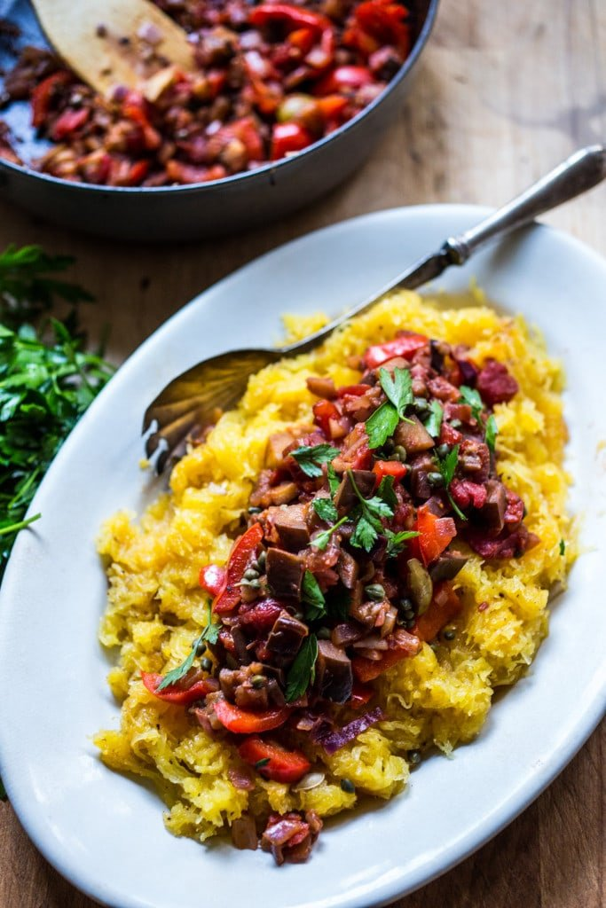 Roasted Spaghetti Squash with Eggplant Puttanesca Sauce- a rich, robust vegetarian meal that is low in carbs, keto and gluten free! Easy and simple. | #keto #spaghettisquash #eggplant #puttnesca #vegan #vegandinner