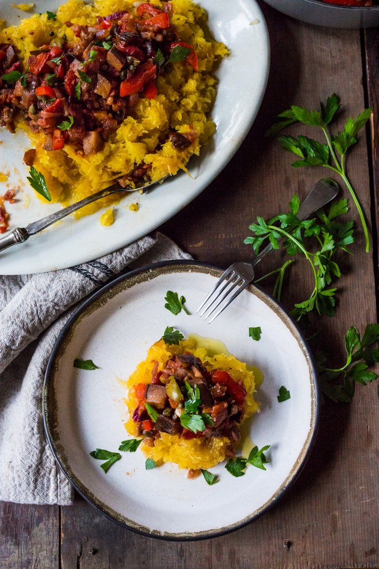 Eggplant Puttanesca over Roasted Spaghetti Squash- vegan, gluten free and delicious! | feastingathome.com