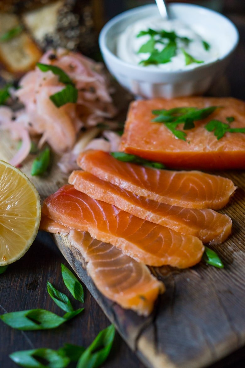 Homemade Lox! How to make lox at home using salt, vodka, herbs and lemon zest. A simple step by step process that only takes 20 minutes of hands on time! #lox #loxrecipe