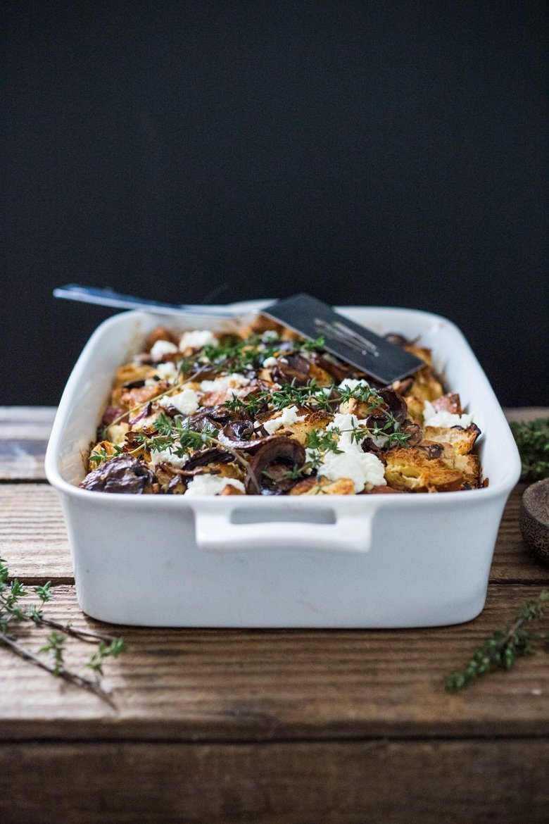 A delicious Baked Egg Casserole called Breakfast Strata with mushrooms, caramelized onions, goat cheese and thyme, perfect for the holidays. Make it ahead! | www.feastingathome.com