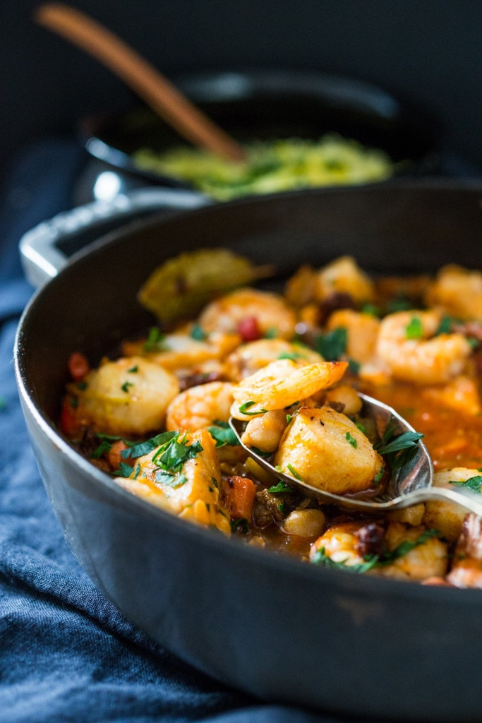 A simple delicious recipe for Spanish Seafood Stew with Garbanzo beans and Chorizo ( or soy Chorizo) served over Jasmine infused rice. | www.feastingathome.com