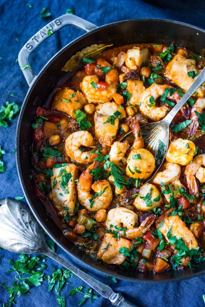 A simple delicious recipe for Spanish Seafood Stew with Garbanzo beans and Chorizo ( or soy Chorizo) served over Jasmine infused rice.   www.feastingathome.com