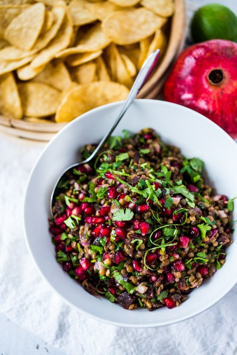 "A take on ""Texas Caviar"", this Lentil Dip dip called Palouse Caviar is made w/ Northwest Palouse grown lentils, pomegranate, avocado, lime & served with corn chips for a festive healthy, vegan GF appetizer. 
