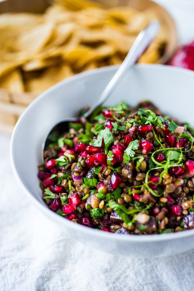 """A take on """"Texas Caviar"""", this Lentil Dip dip called Palouse Caviar is made w/ Northwest Palouse grown lentils, pomegranate, avocado, lime & served with corn chips for a festive healthy, vegan GF appetizer.   www.feastingathome.com"""
