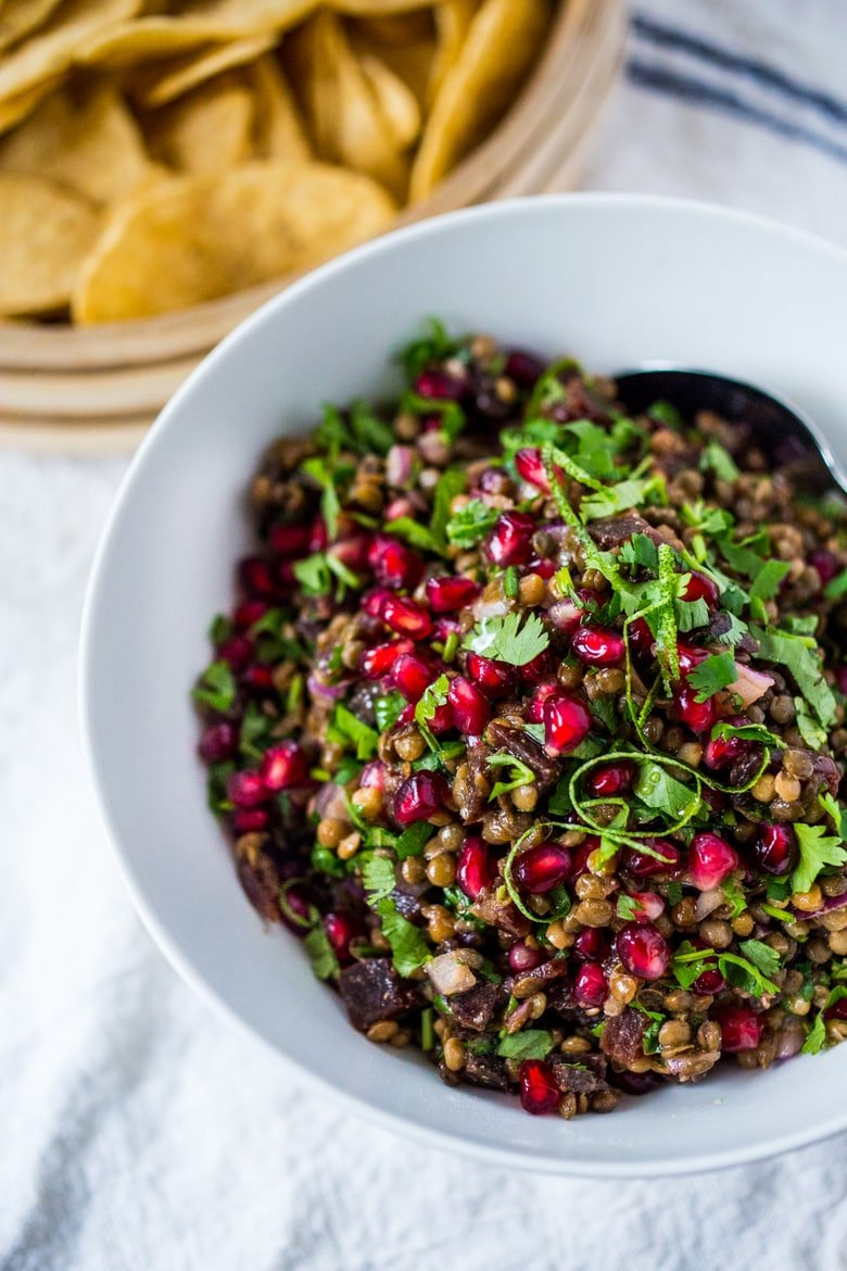 Palouse Caviar!  A take on Texas Caviar, this Lentil Dip called Palouse Caviar is made w/ Northwest Palouse grown lentils, pomegranate, avocado, lime. Served with corn chips for a festive healthy, vegan GF appetizer.