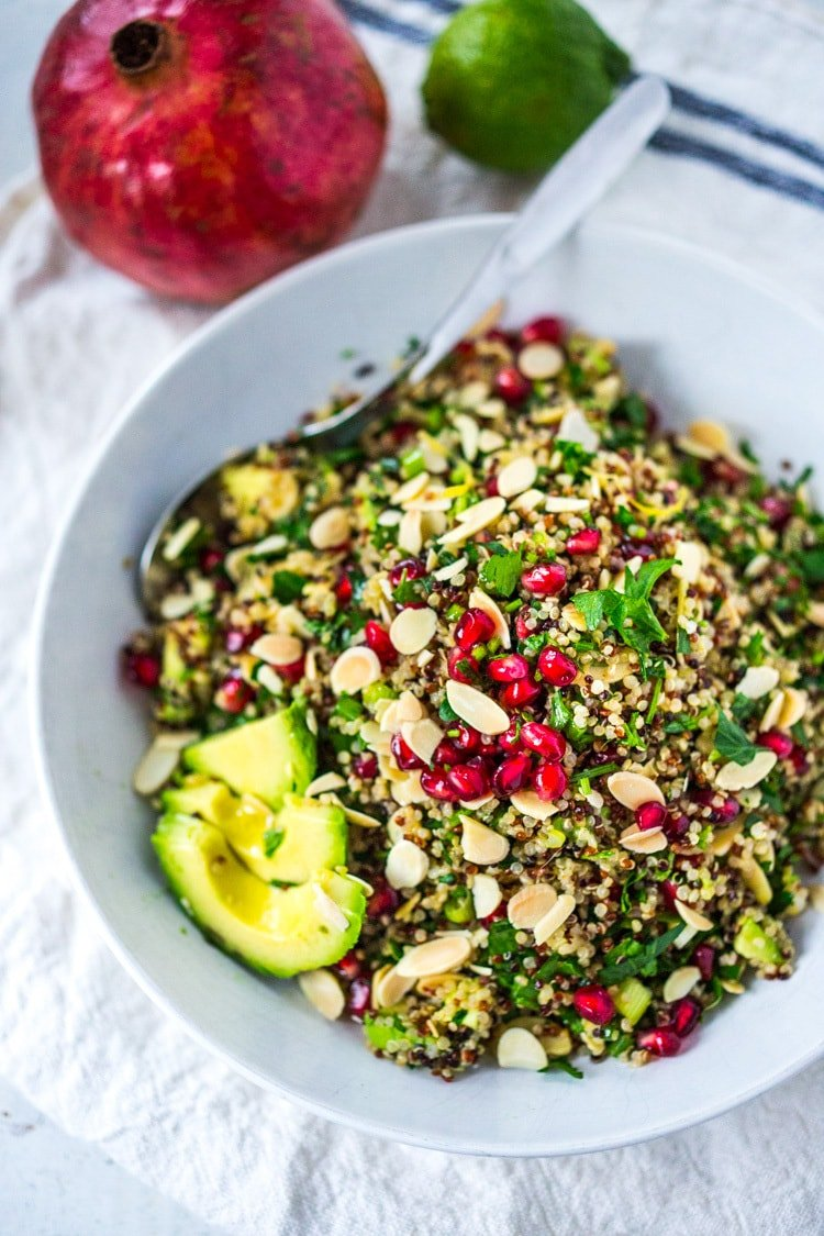 Holiday Crunch Salad - w/ Quinoa, Pomegranate Seeds, avocado, parsley and toasted Almonds...a healthy vegan gluten -free salad to your holiday table! | #vegansalad #healthysalad #christmassalad #pomegranate #quinoa #quinoasalad |www.feastingathome. com