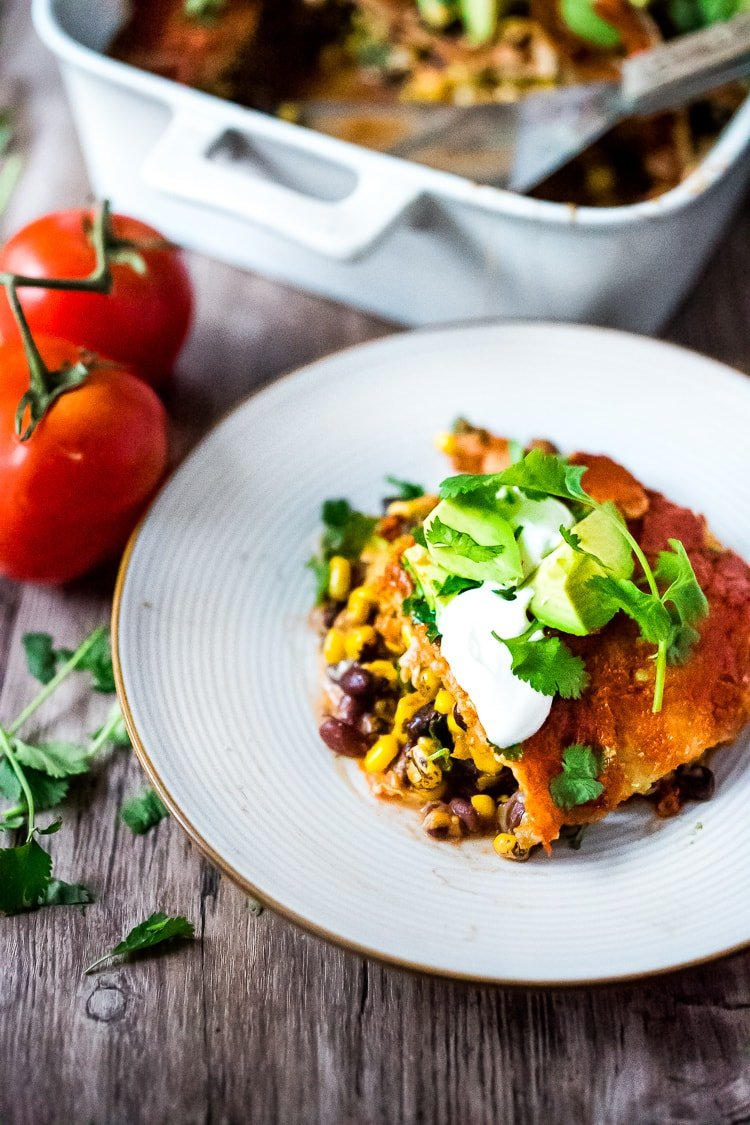 Simple Enchilada Casserole w/ Two Minute Enchilada Sauce! A fast and healthy version ofenchiladas made with layered tortillas instead of rolled- very time saving! Keep it vegetarian or add chicken! | www.feastingathome.com #enchilada #enchiladacassarole #enchiladas #vegetarian #chickenenchiladas
