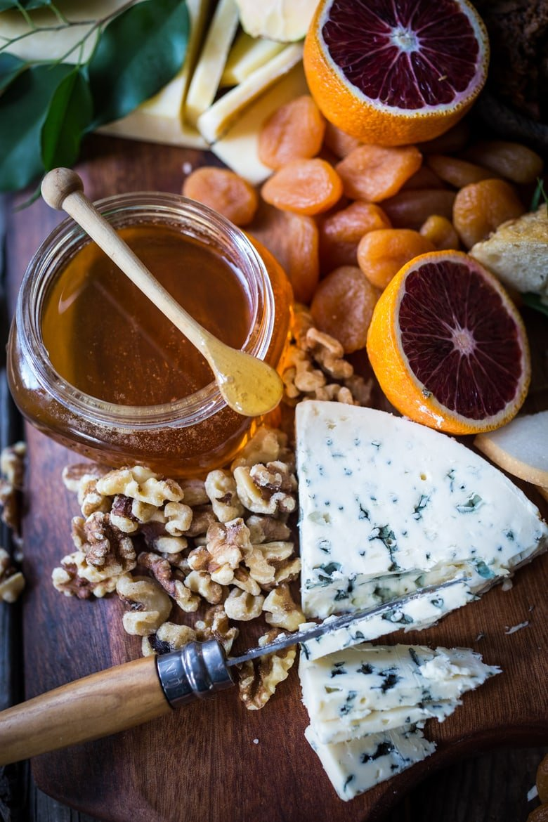 A Winter Cheese Board with Blood Orange Marmalade and Castello cheeses, winter fruits, nuts honey and Folie a Duex Wine....a match made in heaven. | www.Feastingathome.com