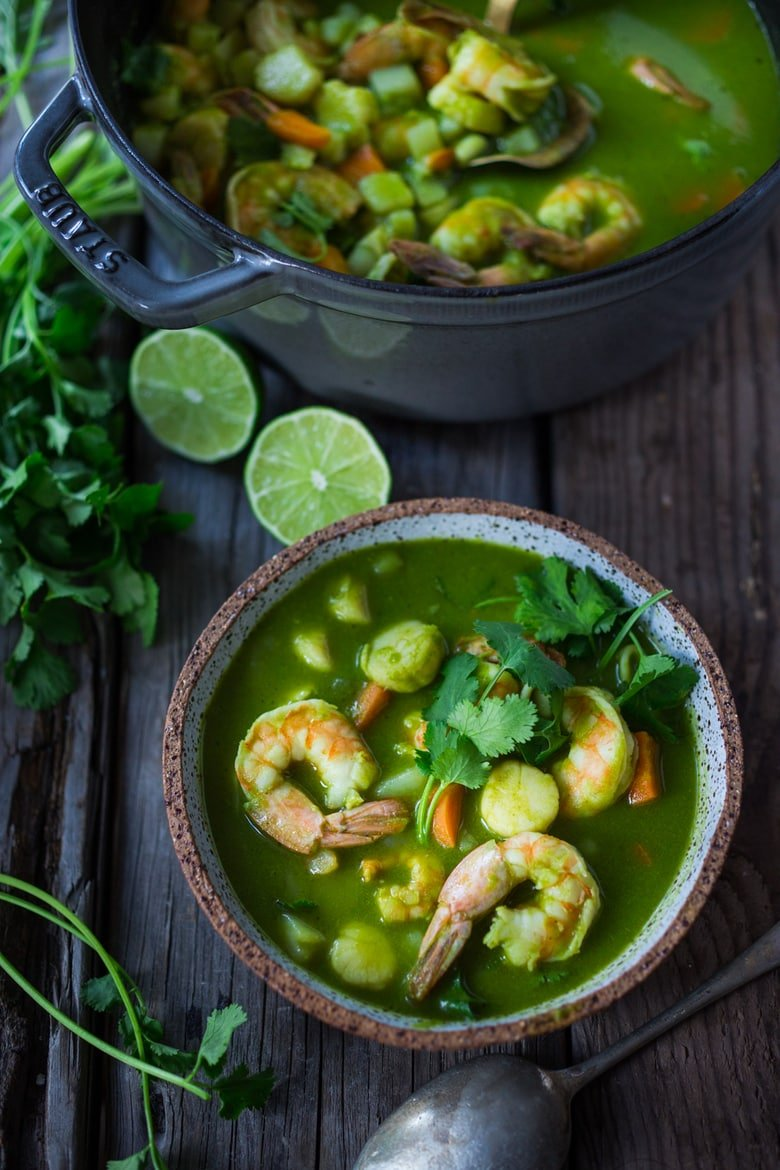 Peruvian Seafood Stew with Cilantro Broth- made with fish and shellfish, potatoes, carrots and the most flavorful delicious broth! Healthy, Paleo, Gluten free, Easy! Can be made in 35 minutes! | #seafoodstew #fishstew #seafoodsoup #peruvian #peruviansoup #peruvianfood www.feastingathome.com