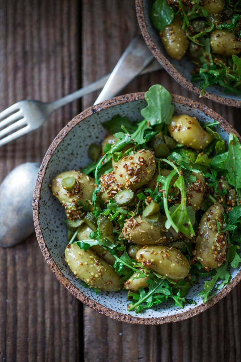 Vegan Potato Salad with Mustard Seed Vinaigrette (No Mayo!) A simple, healthy recipe, great for midweek lunches or make ahead for potlucks and gatherings. #veganpotatosalad #potatosaladrecipe #healthypotatosalad #nomayo #makeadheadsalad | www.feastingathome.com