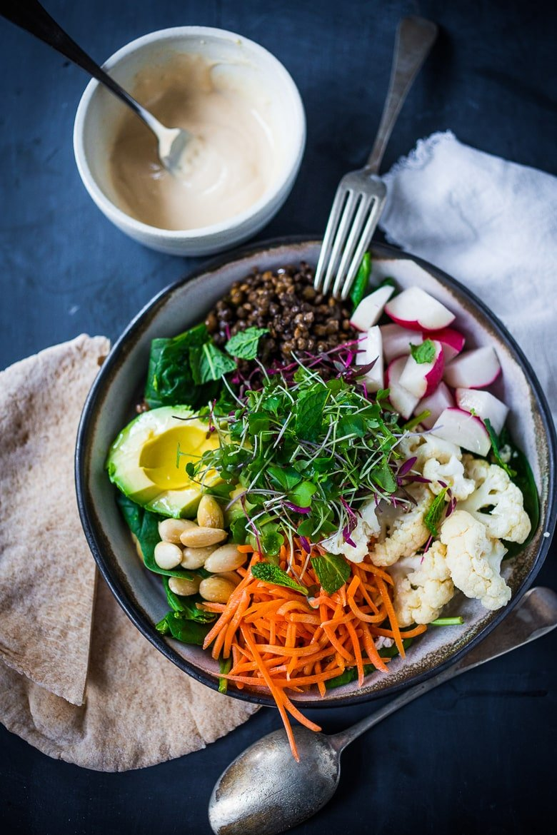 "Minted Lentil Veggie Bowl - a healthy veggie bowl with lentils, seasonal veggies, almonds, avocado and a quick ""hummus"" dressing. Vegan and GF"