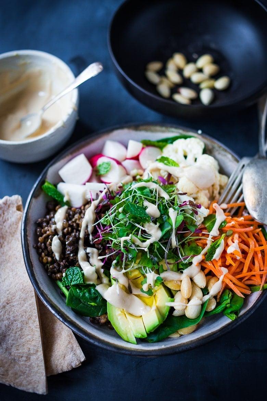 Lentil Bowls - a healthy veggie bowl with lentils, seasonal veggies, almonds, avocado and Tahini dressing. Vegan and GF #buddhabowl #veganbowl #lentil #lentilbowl |www.feastingathome.com