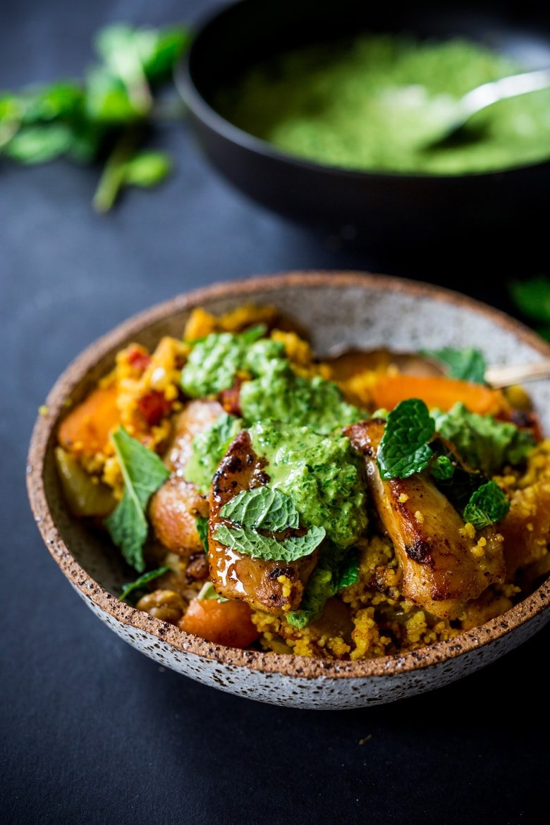 A delicious Tunisian-inspiredTagine (with your choice of Chicken or chickpeas) Carrots, Cous Cous and flavorful Green Harissa Sauce. A one-pan meal that can be made in 45 minutes! Vegan and Gluten-free adaptable! | www.feastingathome.com #tunisian #chicken #chickpeas #couscous #moroccan #moroccanchicken #tagine #taginerecipes