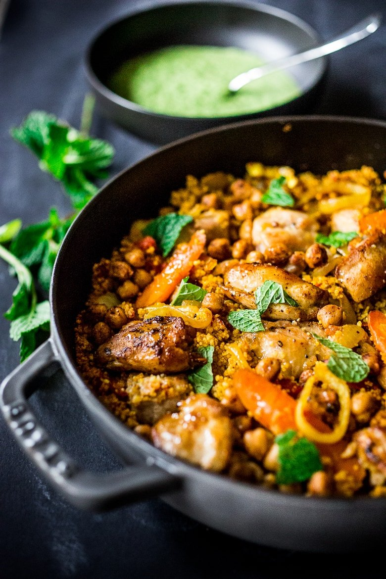 A delicious Tunisian-inspiredTagine (with your choice of Chicken or chickpeas) Carrots, Cous Cous and flavorful Green Harissa Sauce. A one-pan meal that can be made in 45 minutes! Vegan and Gluten-free adaptable!
