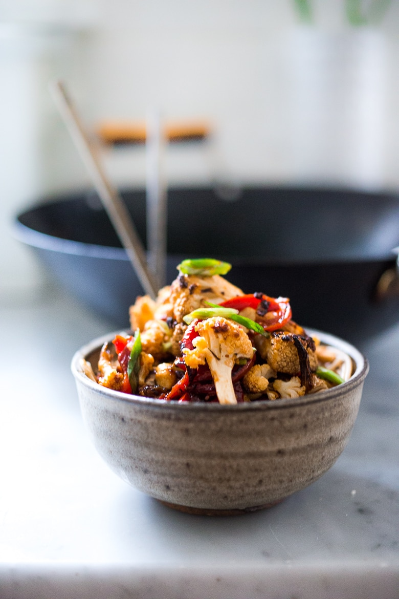 Kung Pao Noodles with roasted cauliflower served over noodles. | www.feastingathome.com