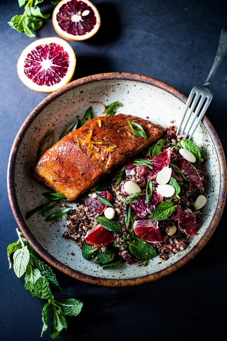 A healthy delicious recipe for Moroccan Salmon, paired with a Quinoa salad with orange, mint, almonds and olives. Simple, fast and easy. | www.feastingathome.com #salmon #detox recipes #paleo #healthy