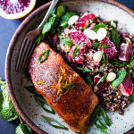 A Simple Moroccan Salmon Recipe that can be made in less than 20 minutes, baked with flavorful Moroccan spices.   www.feastingathome.com #salmon #bakedsalmon #moroccan #moroccanrecipes #moroccansalmon