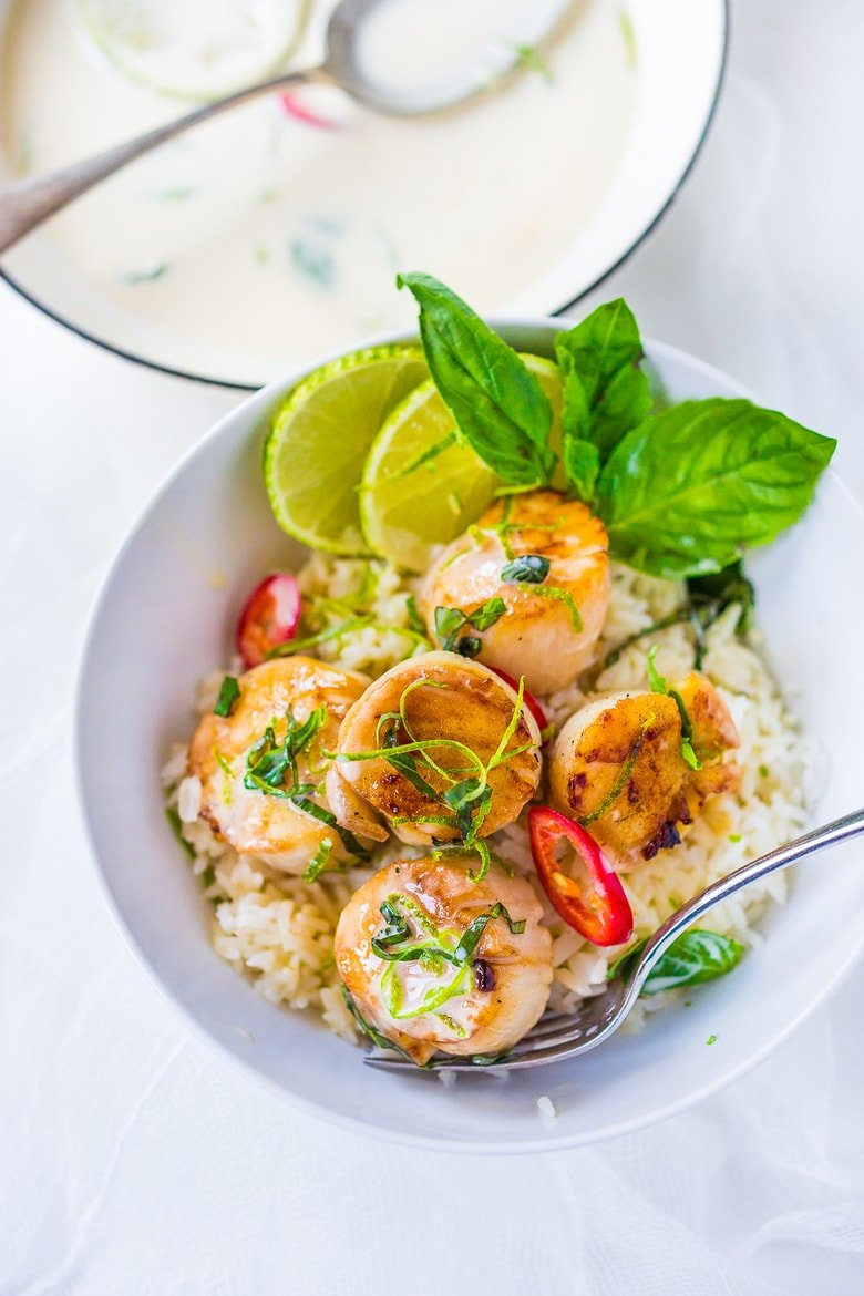Seared Scallops with Coconut Lemongrass Sauce, fresh basil and lime zest. Healthy and delicious, this Thai-inspired dinner is FULL of amazing flavor and easy and quick to make. Feel free to substitute halibut, black cod or shrimp for the scallops!
