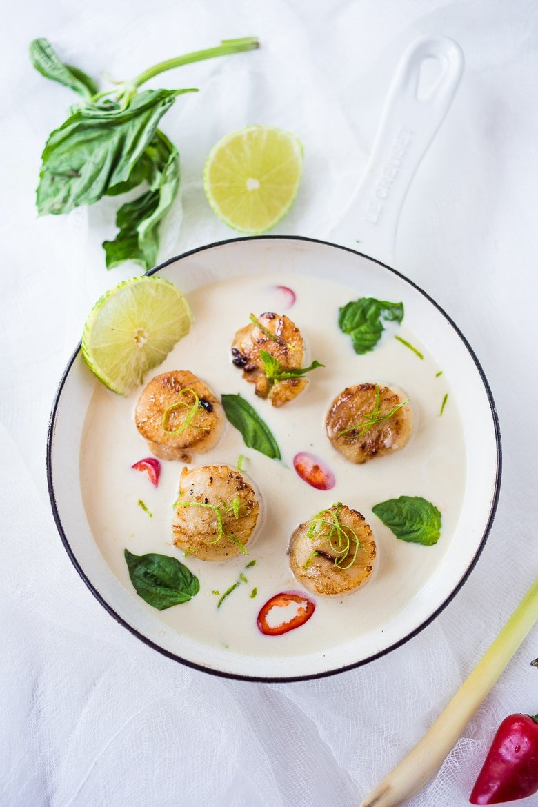 Seared Scallops with fragrant coconut lemongrass sauce, fresh basil and lime zest. FAST, Flavorful and easy to make. A Fresh and healthy recipe! | www.feastingathome.com