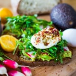 Avocado Toast with arugula, radish, poached #egglandsbest eggs and zataar spice! | ww.feastingathome.com