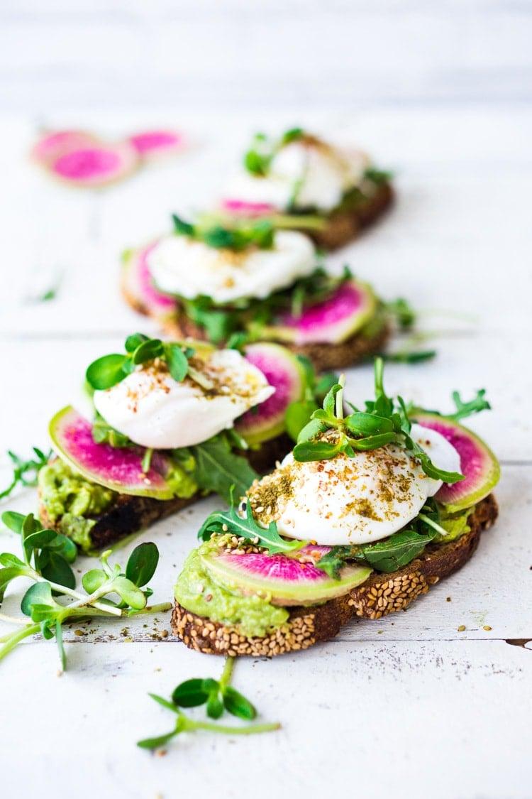 Avocado Toast with Poached Eggs, Arugula, radishes and Zaatar Spice! #avocadotoast #avocado #toast #brunch #breakfast