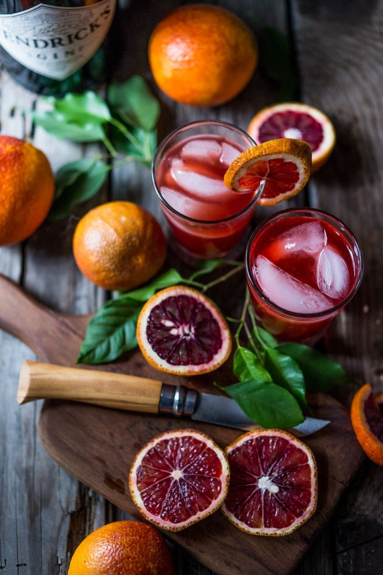 Fresh and juicy blood oranges are in season! Try this recipe for Blood Orange Negroni- a slight twist on the classic, with a splash of Blood Orange juice . | www.feastingathome.com