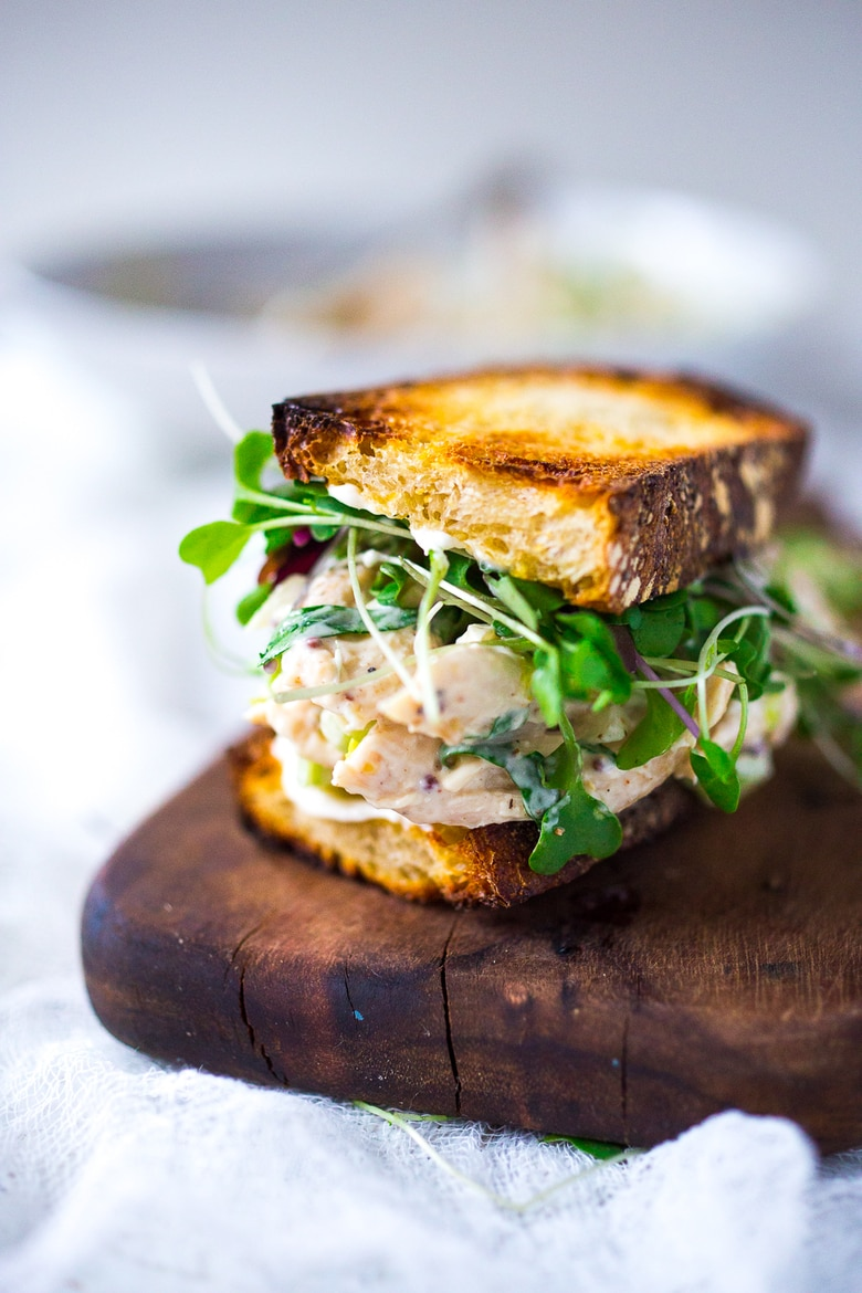 The BEST Chicken Salad Sandwich seasoned with fresh tarragon- easy and full of flavor! Turn this into a wrap or serve over a bed of greens! #chickensaladsandwich #chickensalad #sandwich