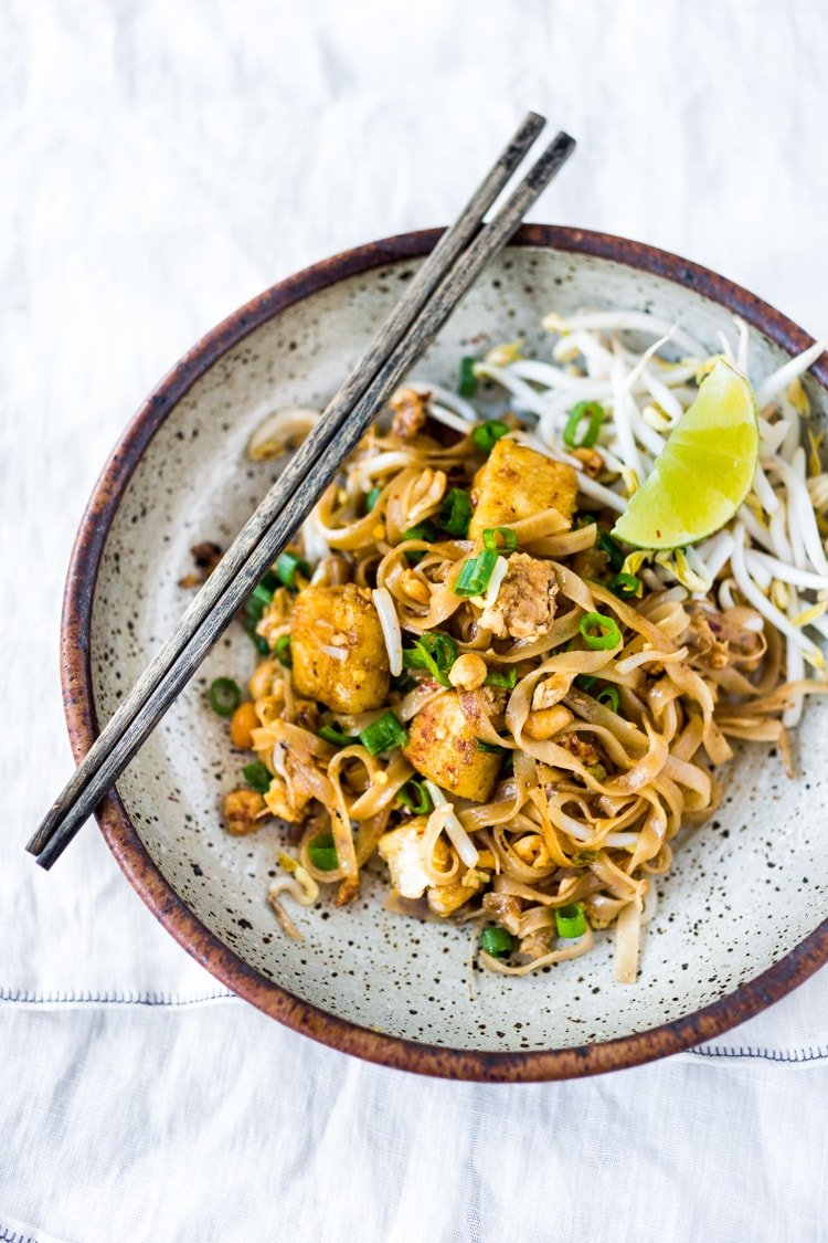 The BEST Pad Thai Recipe made with simple accessible ingredients that is fully customizable! Make this with your choice of chicken, shrimp or tofu! Simple, easy and fast with the BEST flavor!  | #authenticpadthai #easypadthai #padthai #bestpadthai #thai recipes #padthainoodles #bestpadthai www.feastingathome.com