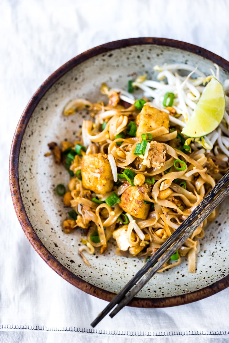 15 MINUTE PAD THAI- an easy & authentic recipe made with simple ingredients! Make with chicken, shrimp or tofu! Gluten free, Vegan adaptable with Incredible flavor ! | Plus more FAST healthy weeknight dinners! | #authenticpadthai #easypadthai #padthai #padthainoodles #weeknightdinners www.feastingathome.com