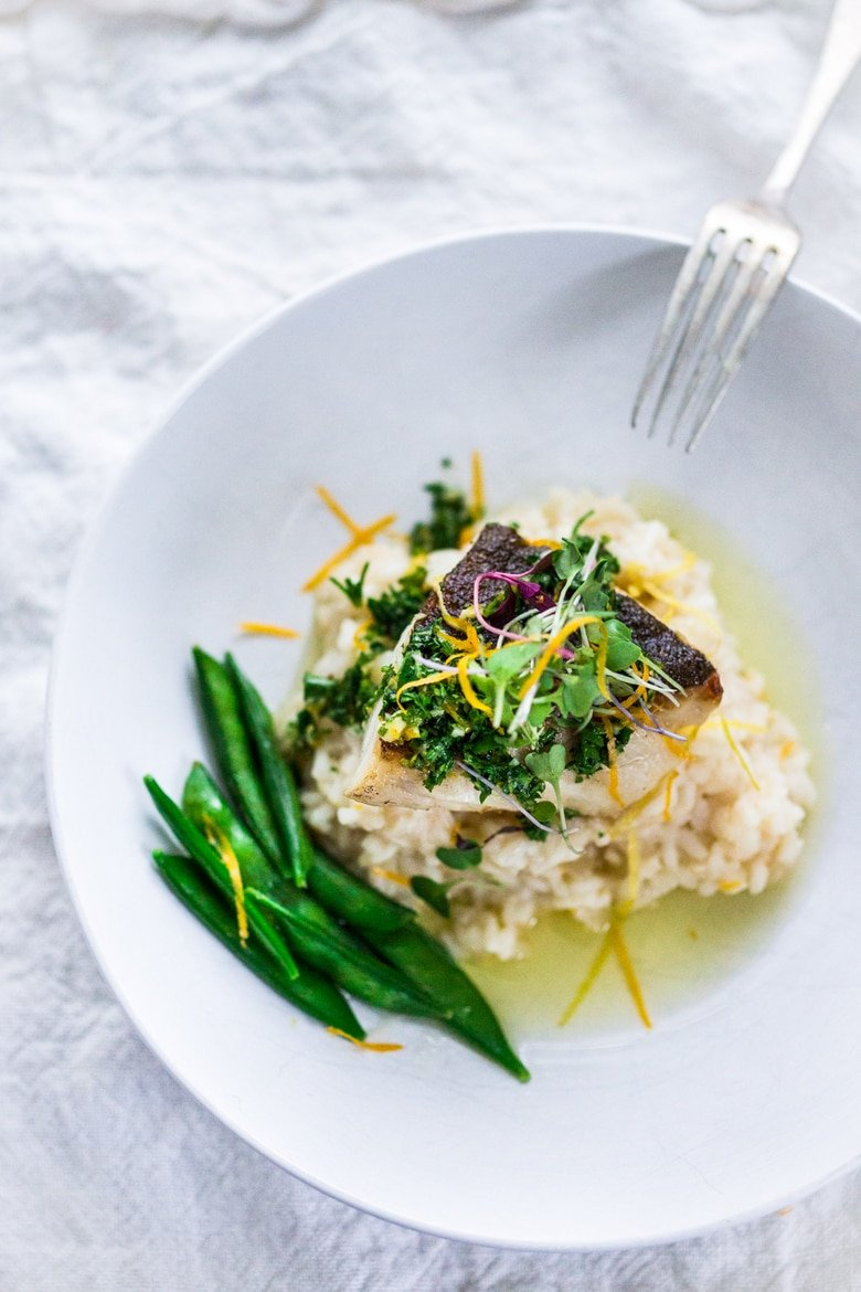 A simple delicious recipe for Seared Black Cod (or halibut, sea bass or scallops) with Meyer Lemon Risotto and Gremolata- a flavorful green herb sauce. | ww.feastingathome.com