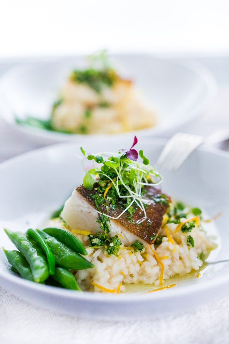 A simple delicious recipe for Seared Black Cod (or halibut, sea bass or scallops) with a lightened up Meyer Lemon Risotto and Gremolata- a flavorful green herb sauce. | ww.feastingathome.com