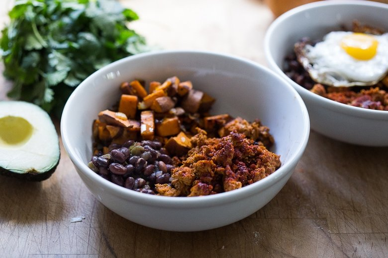 Healthy Yummy Breakfast Bowls with sweet potatoes, blackbeans, turkey chorizo ( optional) avocado, cilantro and and egg. | www.feastingathome.com