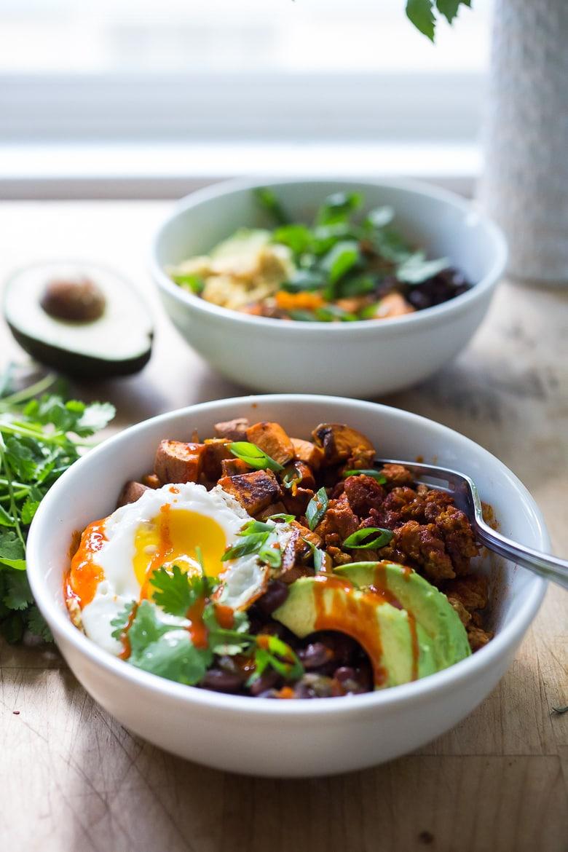 Breakfast Bowls with sweet potatoes, blackbeans, turkey chorizo ( optional) avocado, cilantro and an egg. | www.feastingathome.com