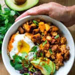 Healthy Yummy Breakfast Bowls with sweet potatoes, blackbeans, turkey chorizo ( optional) avocado, cilantro and an egg. | www.feastingathome.com