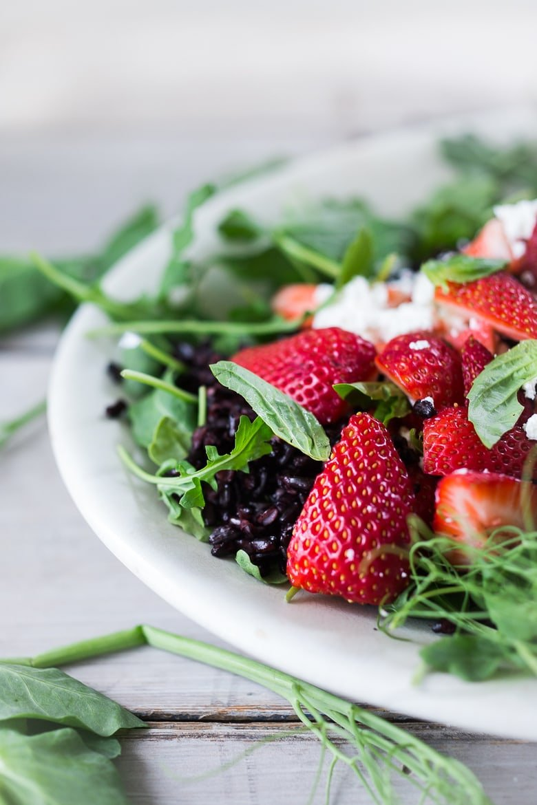 Strawberry Arugula Salad with Basil and Black Rice... with Goat cheese and a simple Balsamic Maple dressing. | www.feastingathome.com