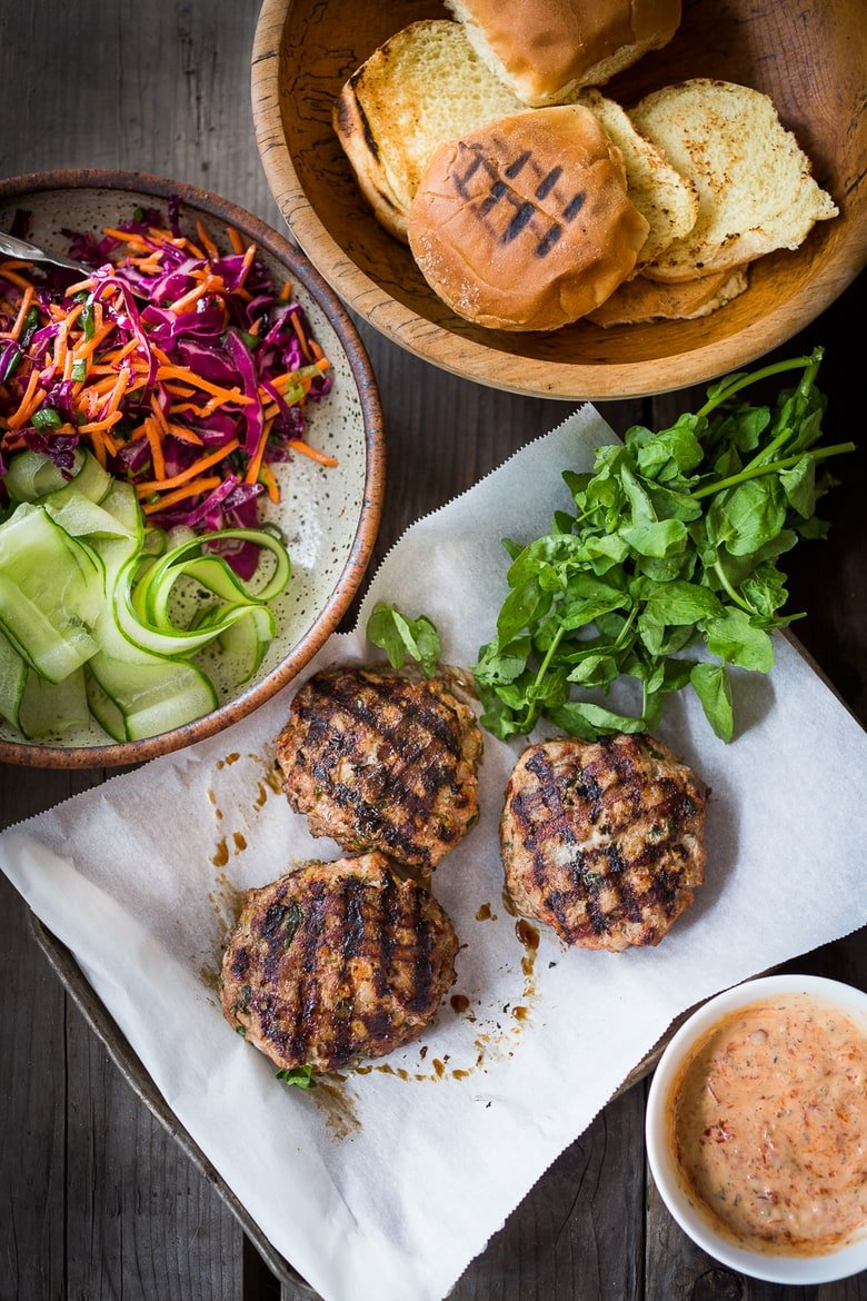 Thai Turkey Burgers- with lemongrass, ginger & basil, topped w/ a Crunchy Asian Slaw and Spicy Aioli. Light, healthy, FLAVORFUL! Easy to make. | www.feastingathome.com #thaiturkeyburger #thaiburger #turkeyburger
