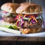 Thai Burgers with Ground turkey, Asian Slaw, Cucumber Ribbons & Spicy Chili Aioli. Light, healthy, Delicious! Easy to make. | www.feastingathome.com #thaiturkeyburger #thaiburger #turkeyburger #asianslaw #carrotslaw #healthyburger